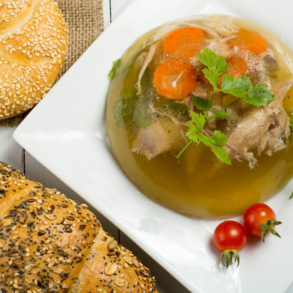 Pork meat with vegetables and herbs in jelly